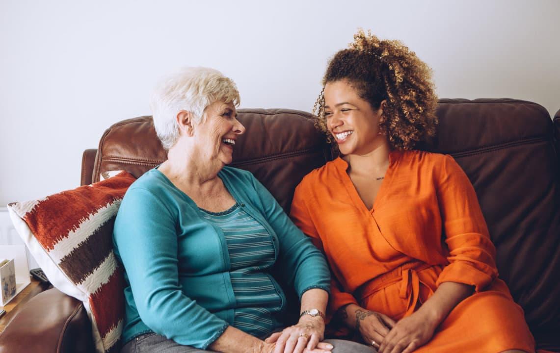 caregiver and a senior woman having a conversation