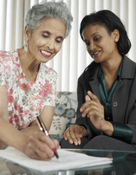 senior woman signing a contract