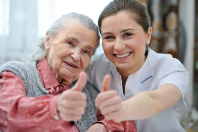 nurse with elder woman beside her