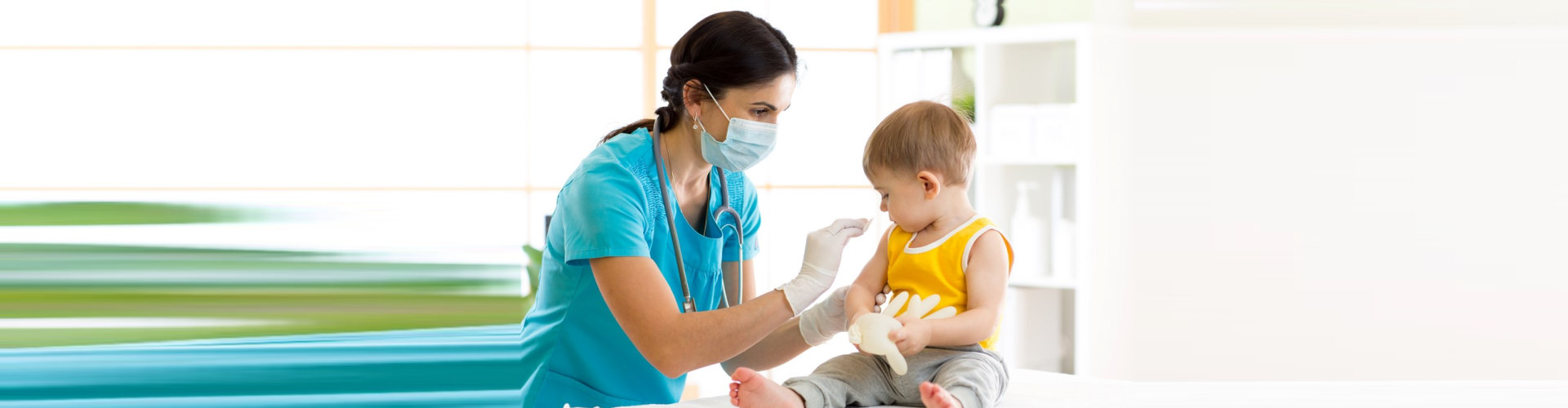 nurse administering vaccine to the child