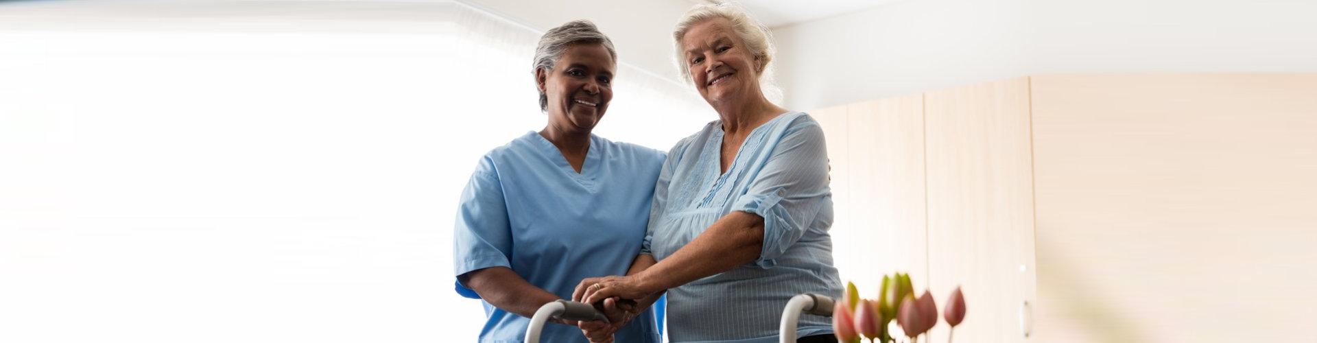 nurse standing by senior woman